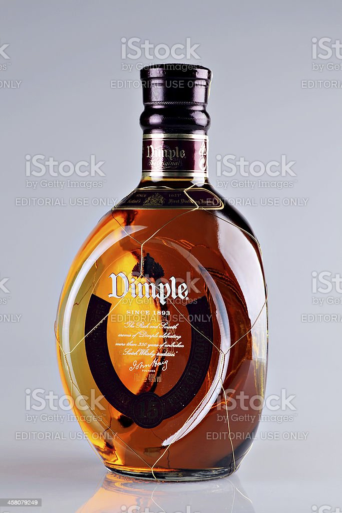 Dimple Scotch Whiskey bottle royalty-free stock photo