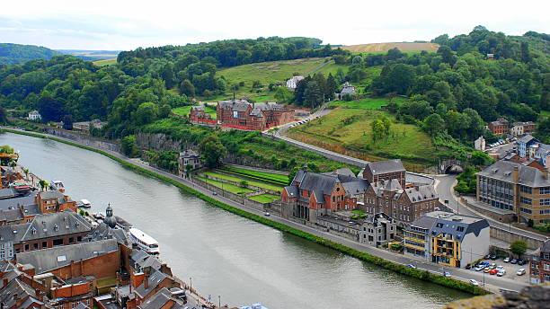 dinant and the river meuse, belgium - maasvallei stockfoto's en -beelden