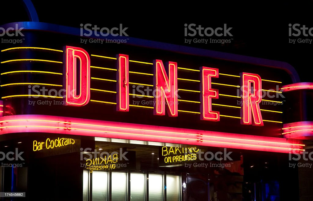 Diner neon sign in red and yellow stock photo