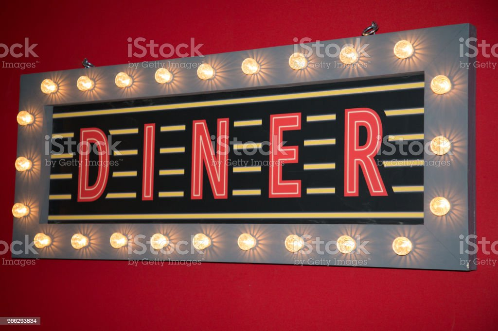 Diner neon sign road on restaurant wall stock photo