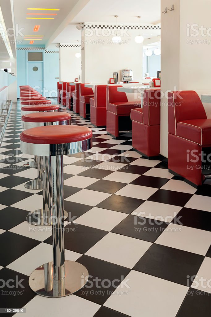 american diner restaurant style in black and white tiles and red...