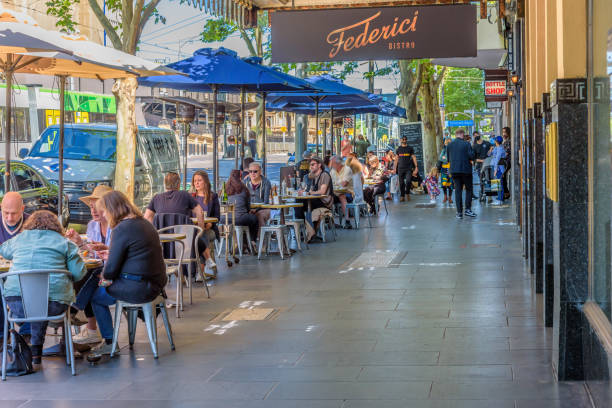 Diners are using outdoor restaurant seating in Melbourne Melbourne, Victoria, Australia, November 1st, 2020: Diners are using outdoor restaurant seating in Melbourne under social distancing rules in the wake of the covid-19 pandemic al fresco dining stock pictures, royalty-free photos & images