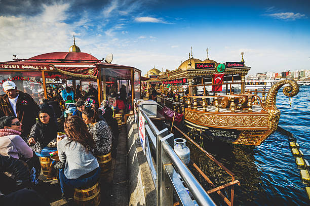 diners at open air fish restaurants in istanbul - eminonu district stockfoto's en -beelden