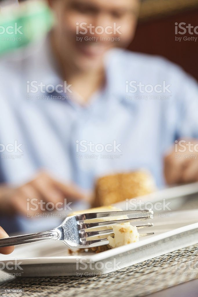 Diners eating dessert, close up of fork royalty-free stock photo