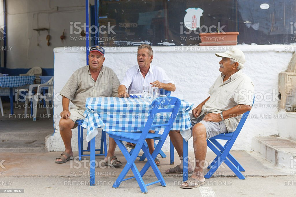 diners sit in a traditional Greek restaurant stock photo