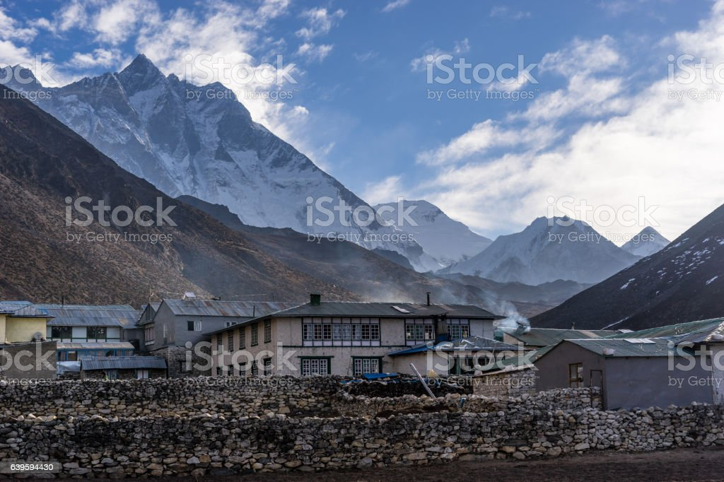 Dingboche village in a morning with Lhotse mountain background, stock photo