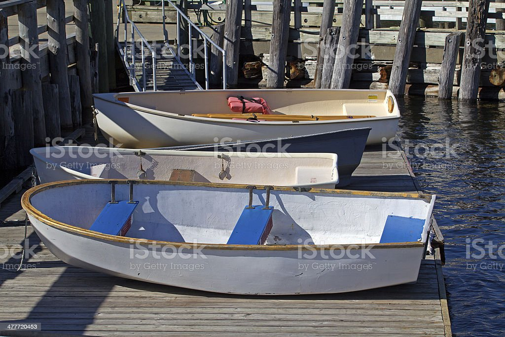Dinghies on a floating dock stock photo