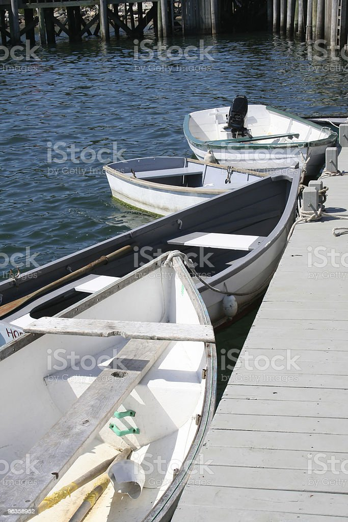 dinghies tied up at dock stock photo