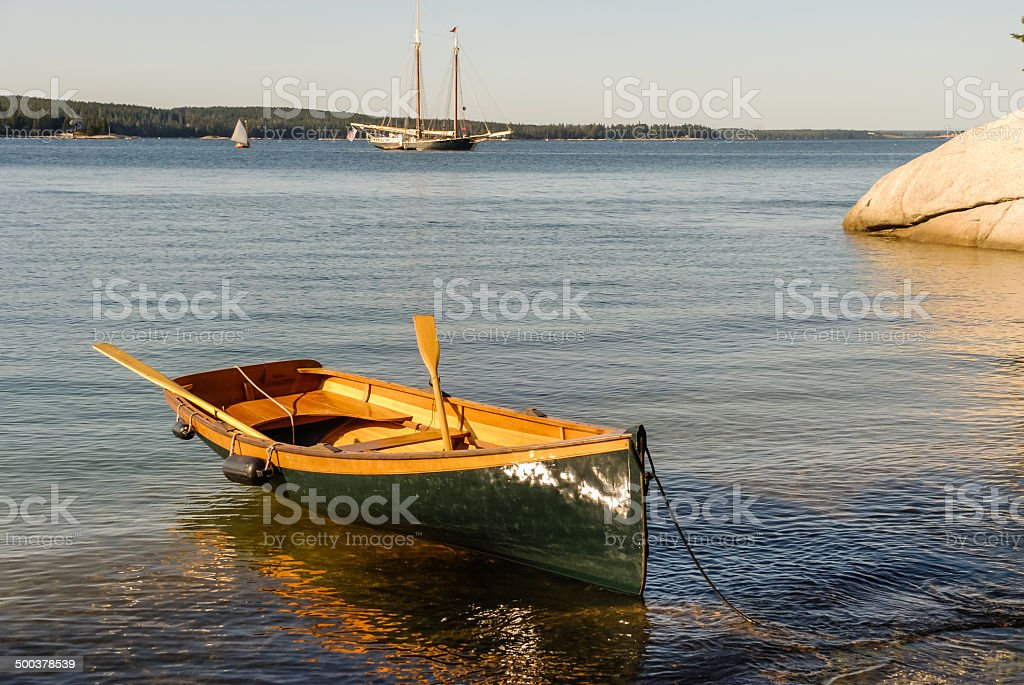 Dinghy and Windjammer Anchored stock photo