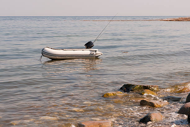 dinghy am strand - angeln dänemark stock-fotos und bilder