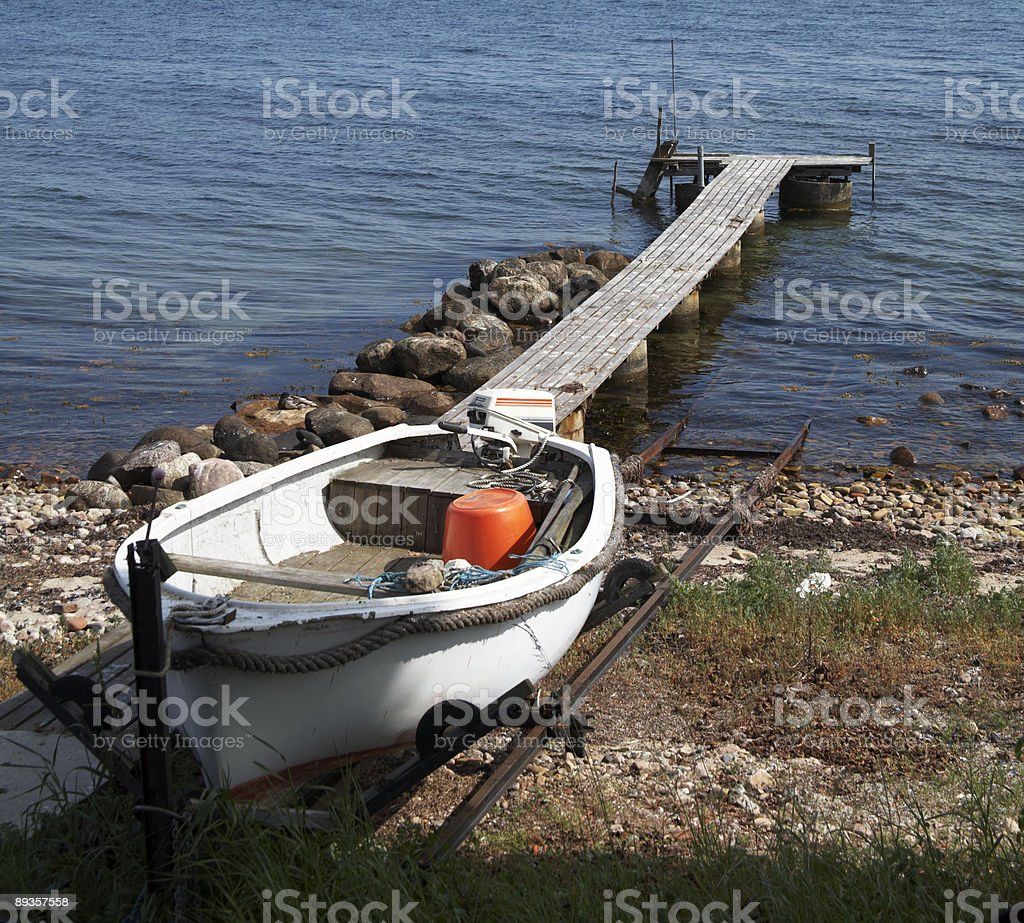 Dinghy at the beach stock photo