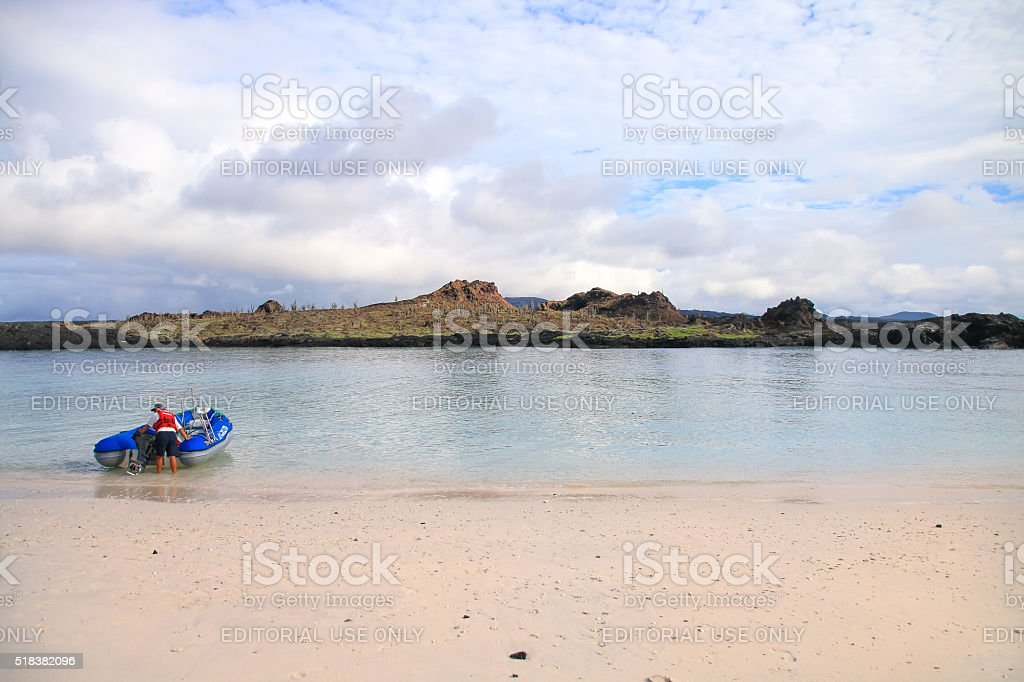 Dinghy motoring from the beach of Chinese Hat island stock photo