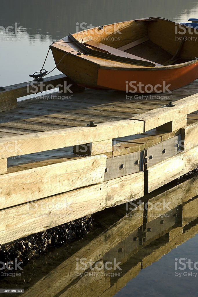 Dinghy on the dock stock photo