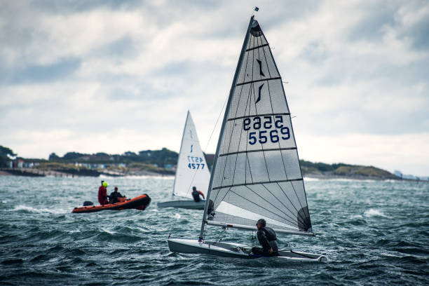 Dinghy Racing Hayling Island A number of Solo and Laser Dinghy Racing at a regular club meeting at Hayling Island sailing club on the southeast coast of England. sailing dinghy stock pictures, royalty-free photos & images