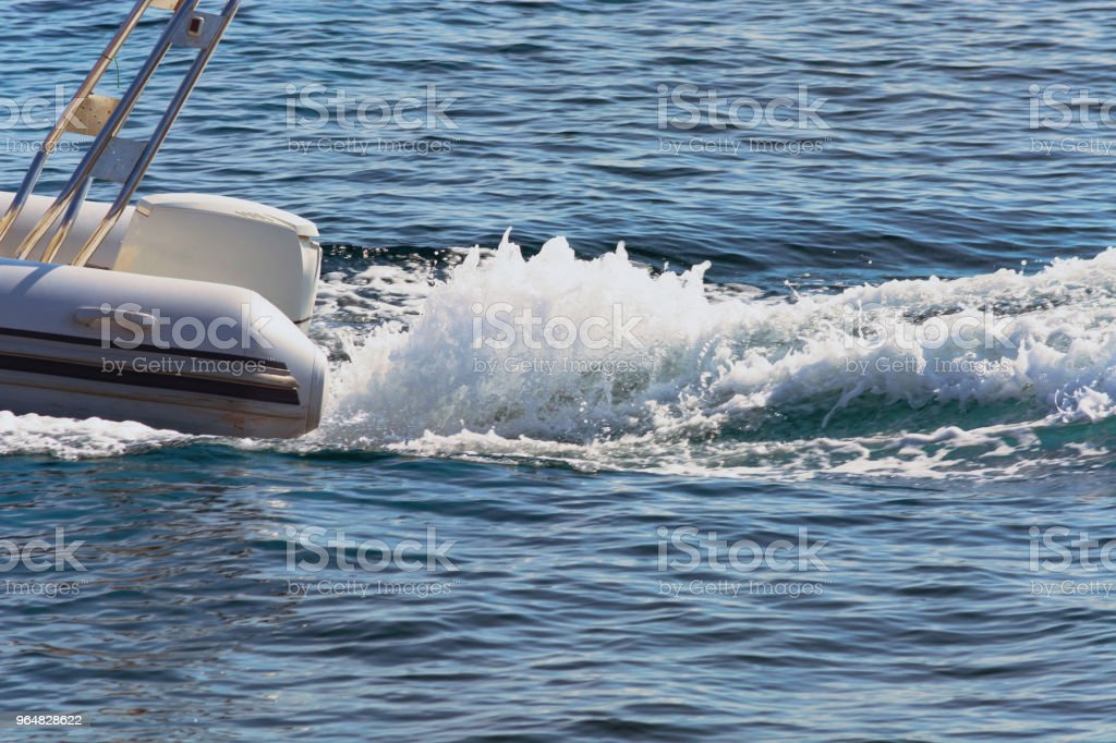 Dinghy with outside board engine royalty-free stock photo