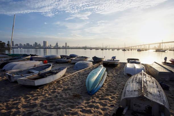 dinghys beached on a sand at daybreak on Coronado Island stock photo