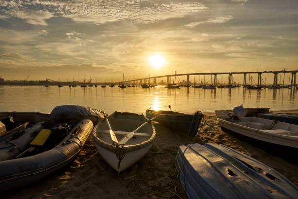 Dinghys on Coronado Island's shore at sunrise stock photo