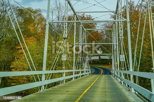 Dingmans Ferry Bridge across the Delaware River in the Poconos Mountains, connecting the states of Pennsylvania and New Jersey, USA