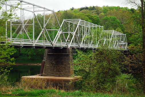 The Dingman's Ferry Bridge is one of the few remaining privately owned toll bridges in the United States.  It spans the Delaware River, connecting New Jersey and Pennsylvania