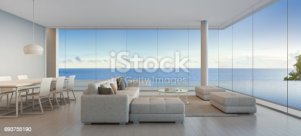 istock Dining and living room of luxury beach house with sea view swimming pool in modern design, Vacation home for big family 693755190