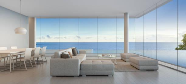 ess- und wohnzimmer von luxus strandhaus mit meerblick anzeigen schwimmbad in modernem design, ferienhaus für große familie - große wohnzimmer stock-fotos und bilder
