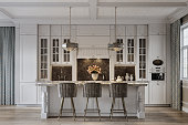 istock Dining area in a beautiful modern kitchen from a large house 1284800611