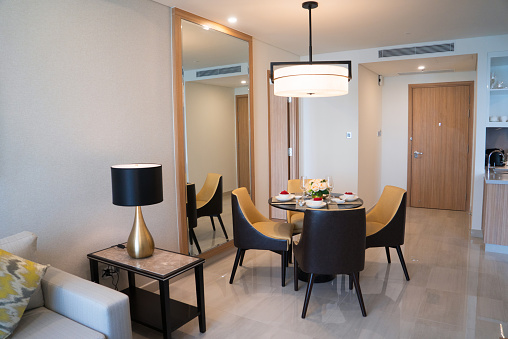 Dining area of comfortable studio flat or hotel room