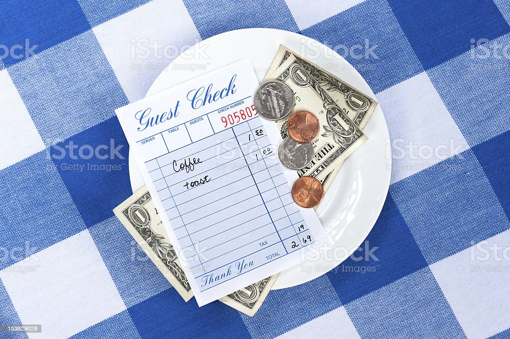 Dining check with change stock photo