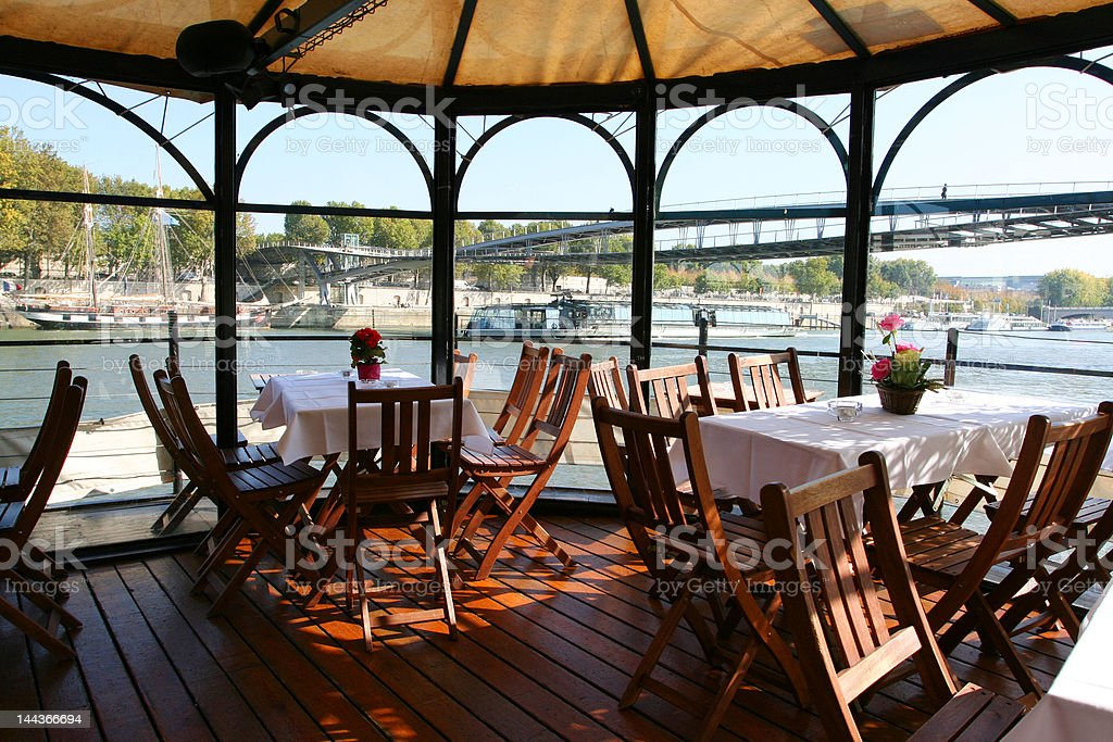 Dining cruise boat on the Seine river in Paris stock photo