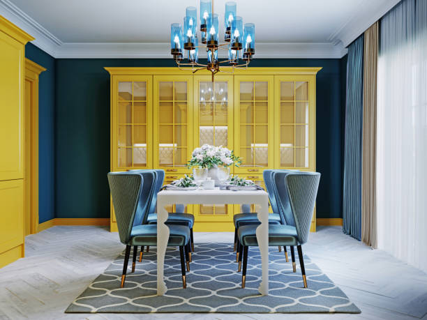 Dining glass table with four soft chairs, kitchen interior in blue and yellow colors.