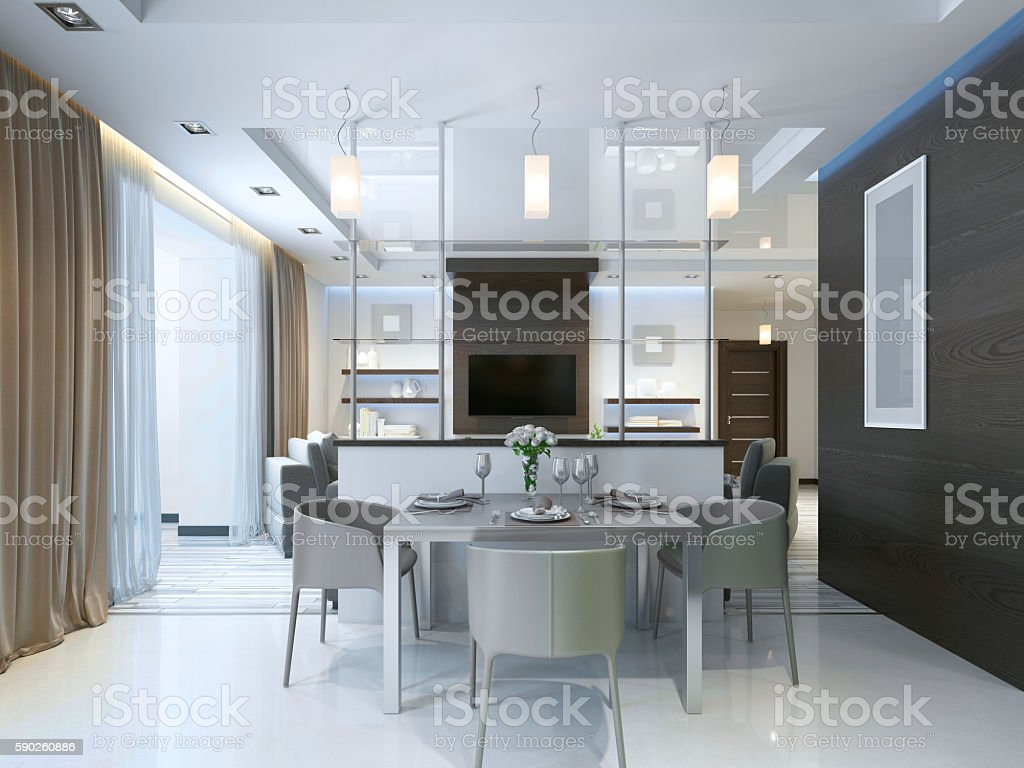Dining in a studio apartment with a dining table and chairs for three...