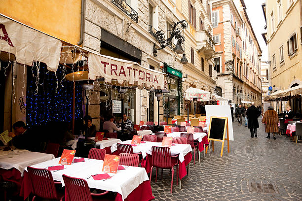 Dining outside in winter in Rome, Italy stock photo