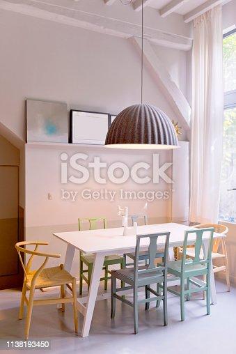 640265128 istock photo Dining room in loft studio. 1138193450
