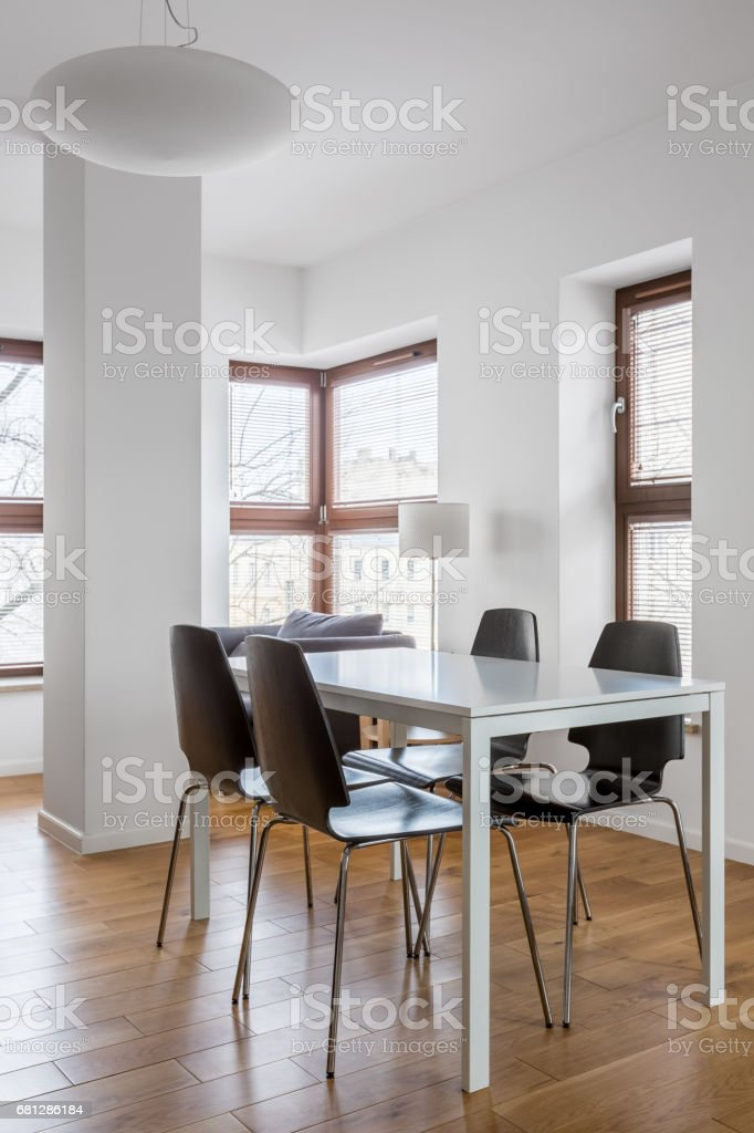 Dining room in modern apartment royalty-free stock photo