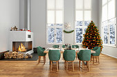 Dining Room With Christmas Tree, Ornaments, Fireplace And Snow View Background