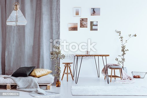 istock Dining room with grey bed 892096024