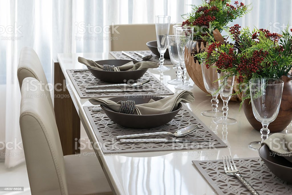 dining table and comfortable chairs in modern home with elegant table...