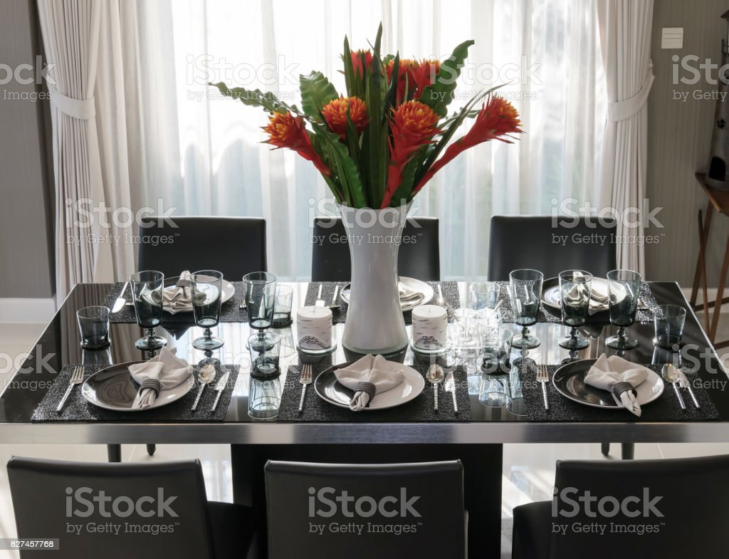 dining table and comfortable chairs in modern home with elegant table setting royalty-free stock & Dining Table And Comfortable Chairs In Modern Home With Elegant ...