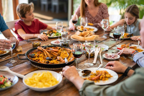 Dining Table Filled with Spanish Midday Meal Specialties stock photo