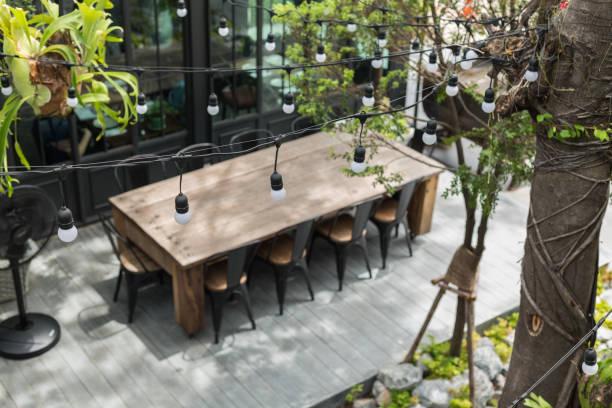 Dining table in backyard garden stock photo