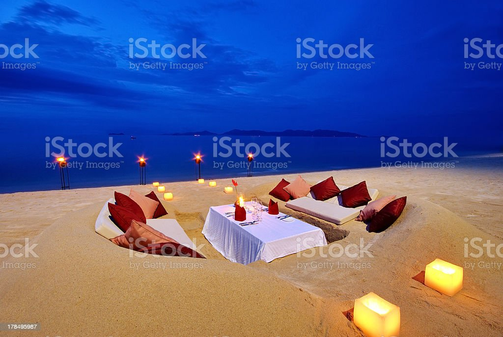 Dining table in the sand royalty-free stock photo