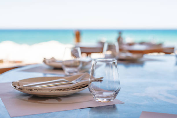 Dining table on the beach Dining table on the beach promenade stock pictures, royalty-free photos & images