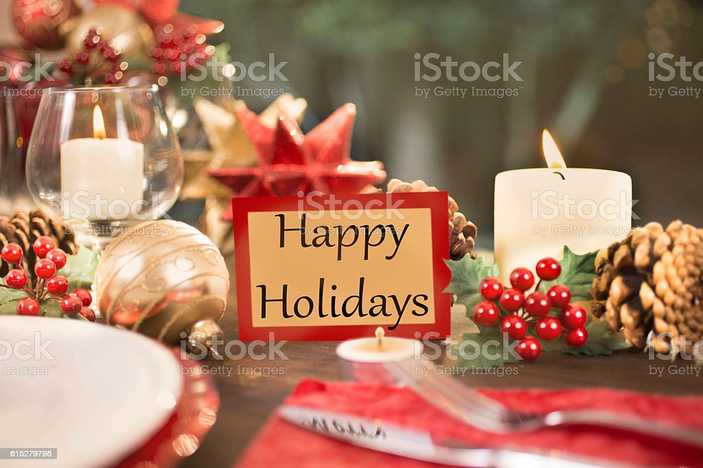Dining table place setting with Christmas decorations. stock photo
