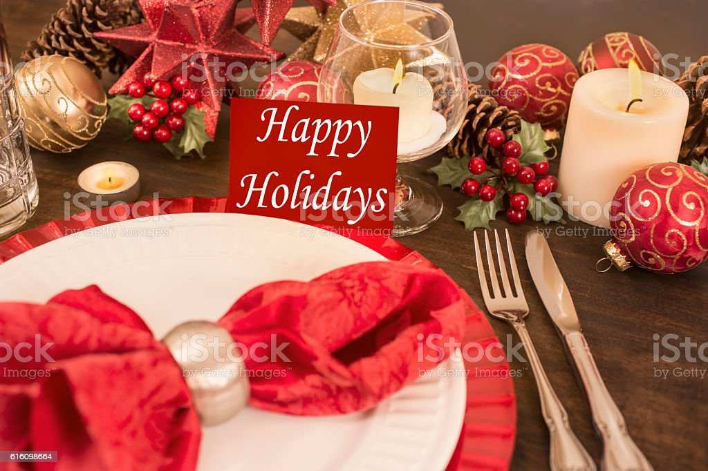 Beautiful Christmas place setting on dining table. \'Happy Holidays\'...