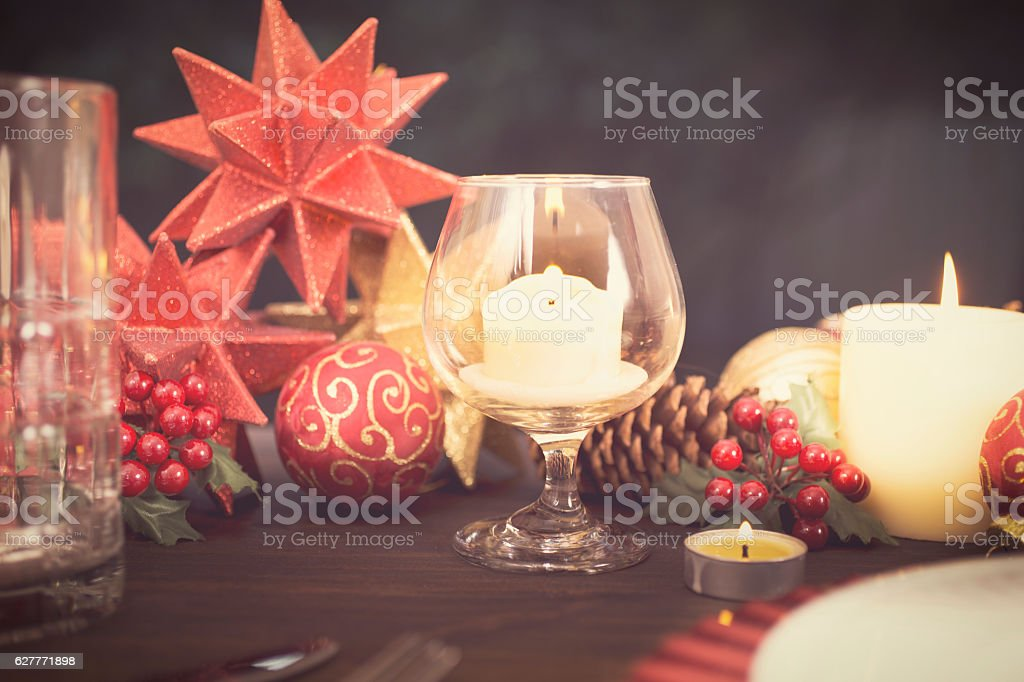 Dining table place setting with Christmas holiday decorations. stock photo
