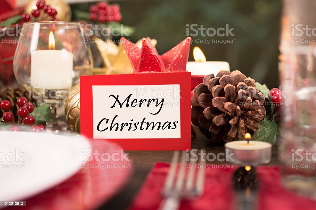 Beautiful Christmas place setting on dining table. \'Merry Christmas\'...