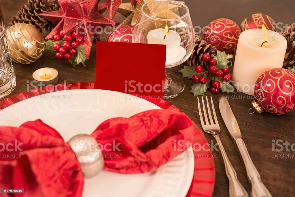 Dining table place setting with Merry Christmas decorations. stock photo