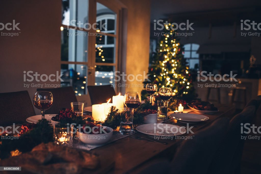 Dining table set for Christmas dinner stock photo