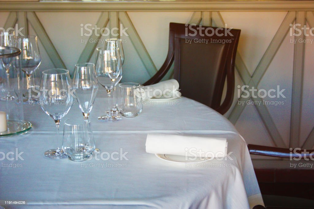 Dining Table Set Up And Set Up With A Lot Of Elegance In The Dining Room Of A Restaurant Or The Dining Room Of A Very Rich House In Light White Colors