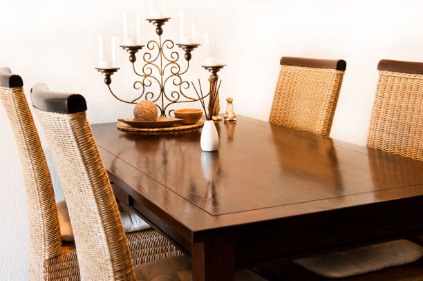 Dining table with chairs and decoration stock photo